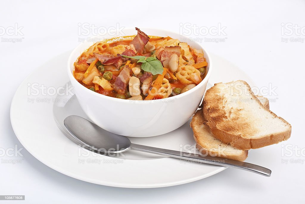 bowl of minestrone with pasta stock photo