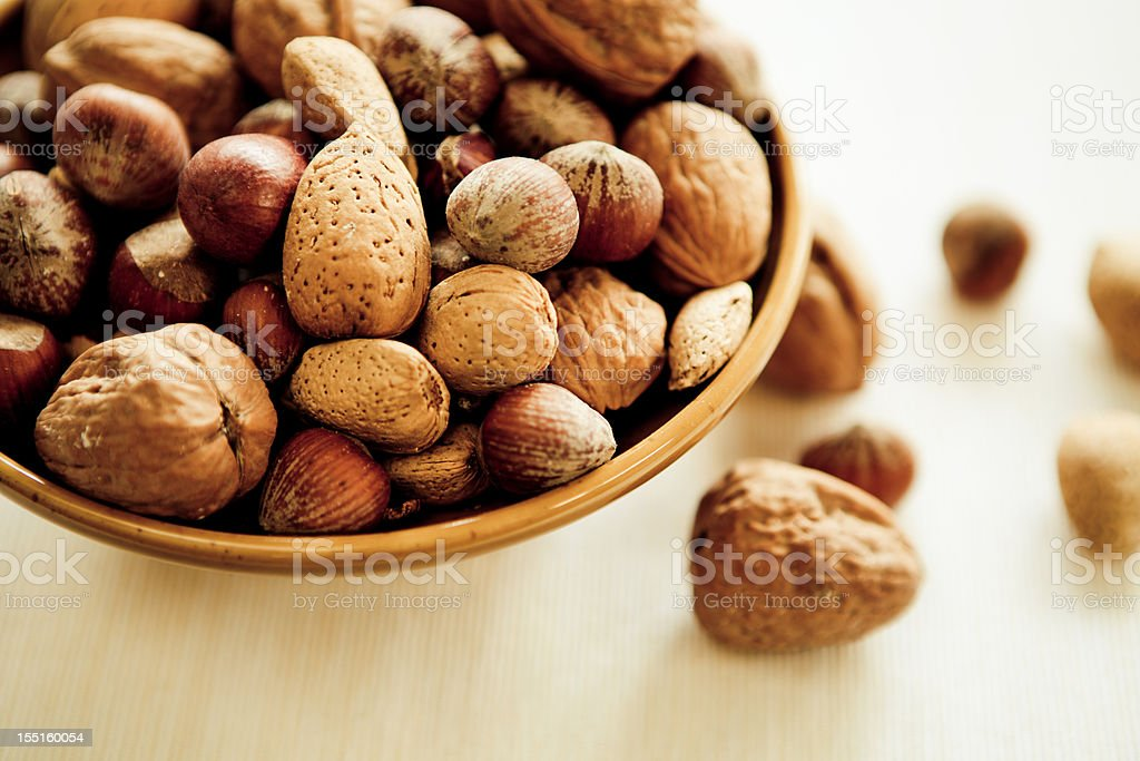 A bowl of mixed nuts still in their shell stock photo