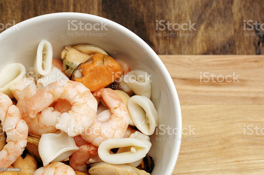 bowl of mixed seafood including king prawns royalty-free stock photo