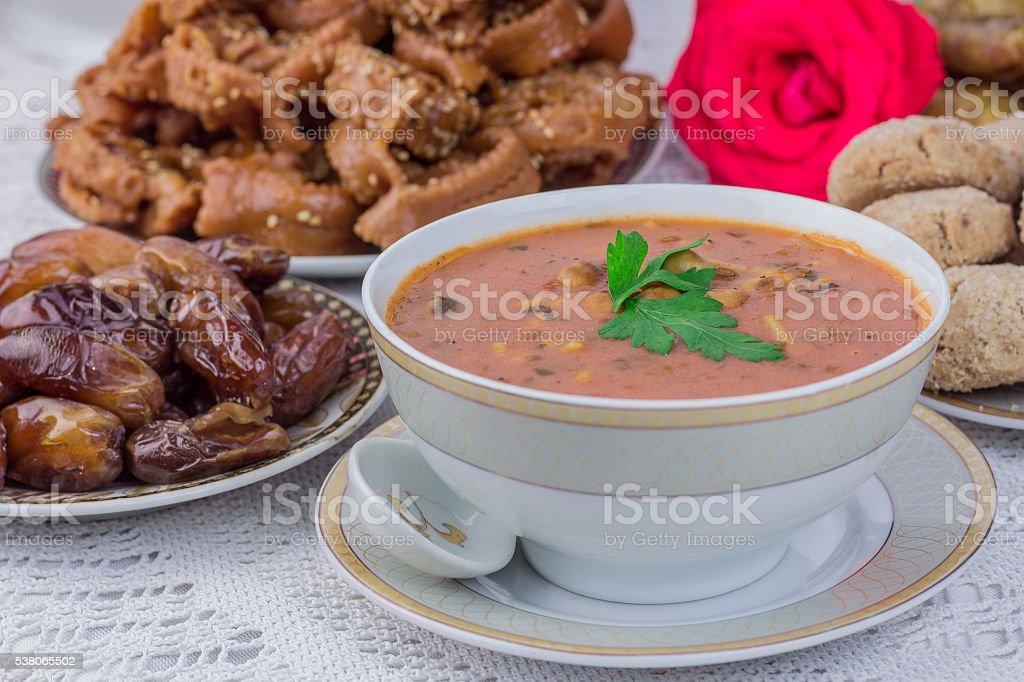 Bowl of Moroccan harira soup,chebakia, dates for iftar stock photo