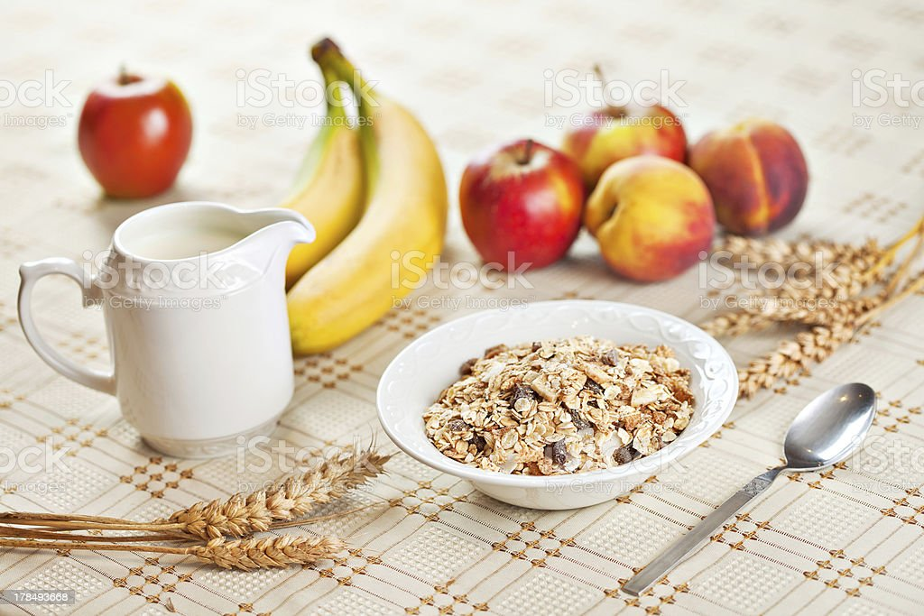 Bowl of muesli for breakfast with fruits royalty-free stock photo