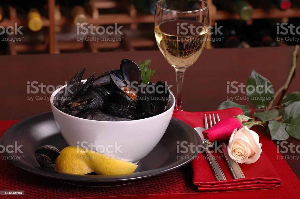 Bowl of mussels in a romantic setting royalty-free stock photo