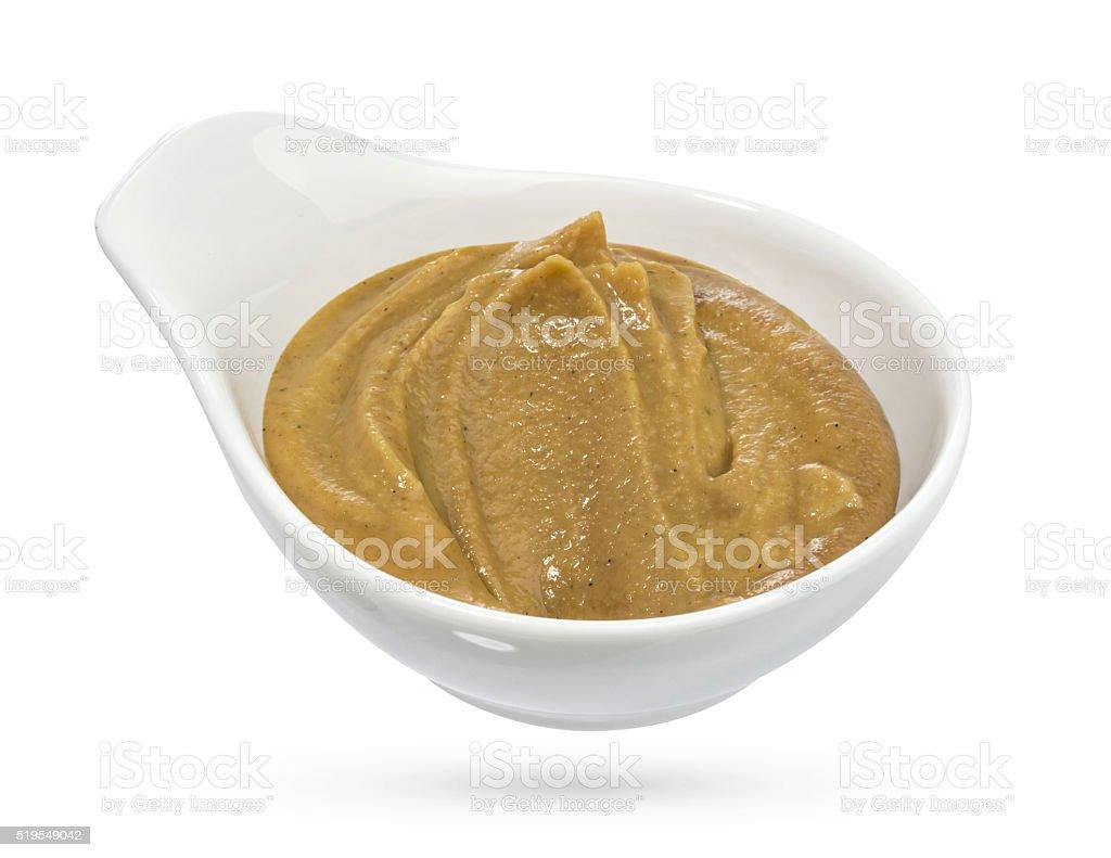 Bowl of mustard on white background. stock photo