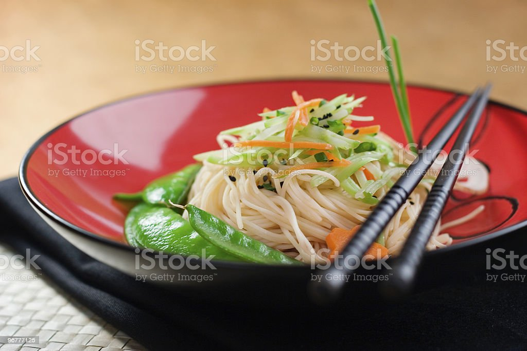 A bowl of noodles and chopsticks royalty-free stock photo