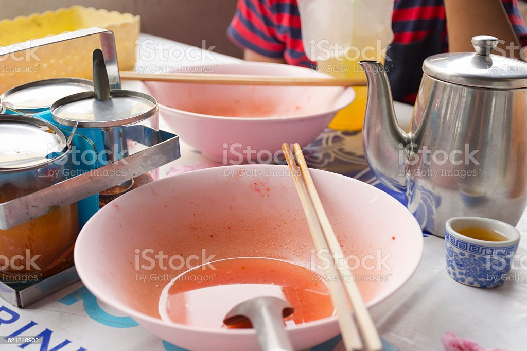 Bowl of noodles to eat out and seasoning with drink stock photo