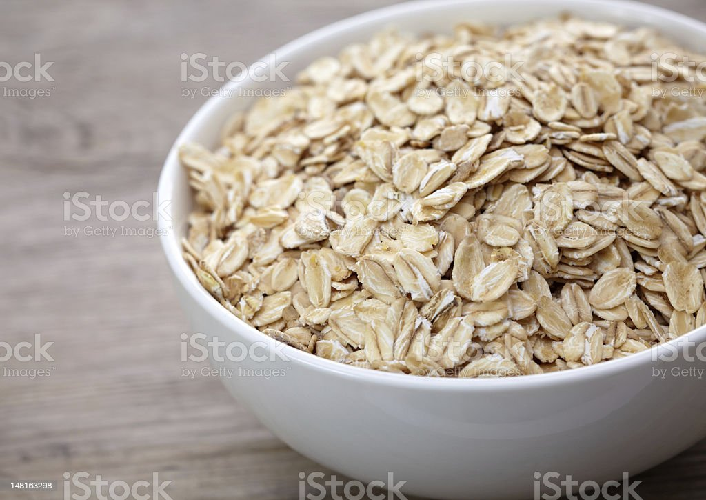 Bowl of oat flakes royalty-free stock photo