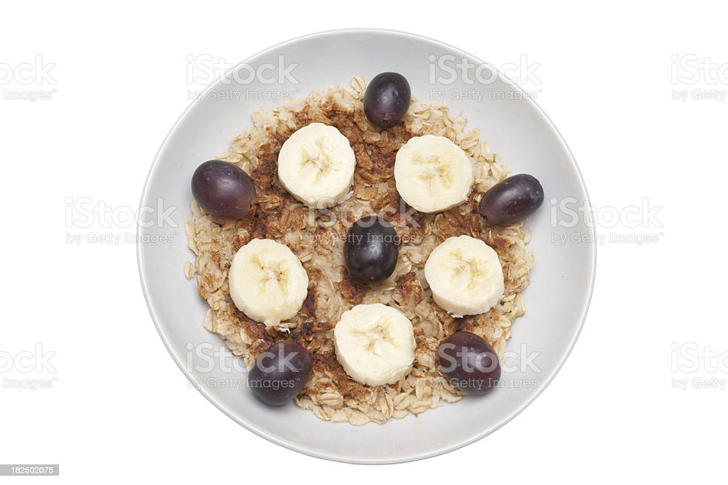 bowl of oatmeal breakfast cereal with fruit royalty-free stock photo
