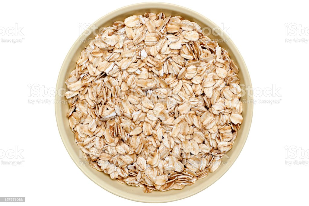 bowl of oatmeal flakes stock photo