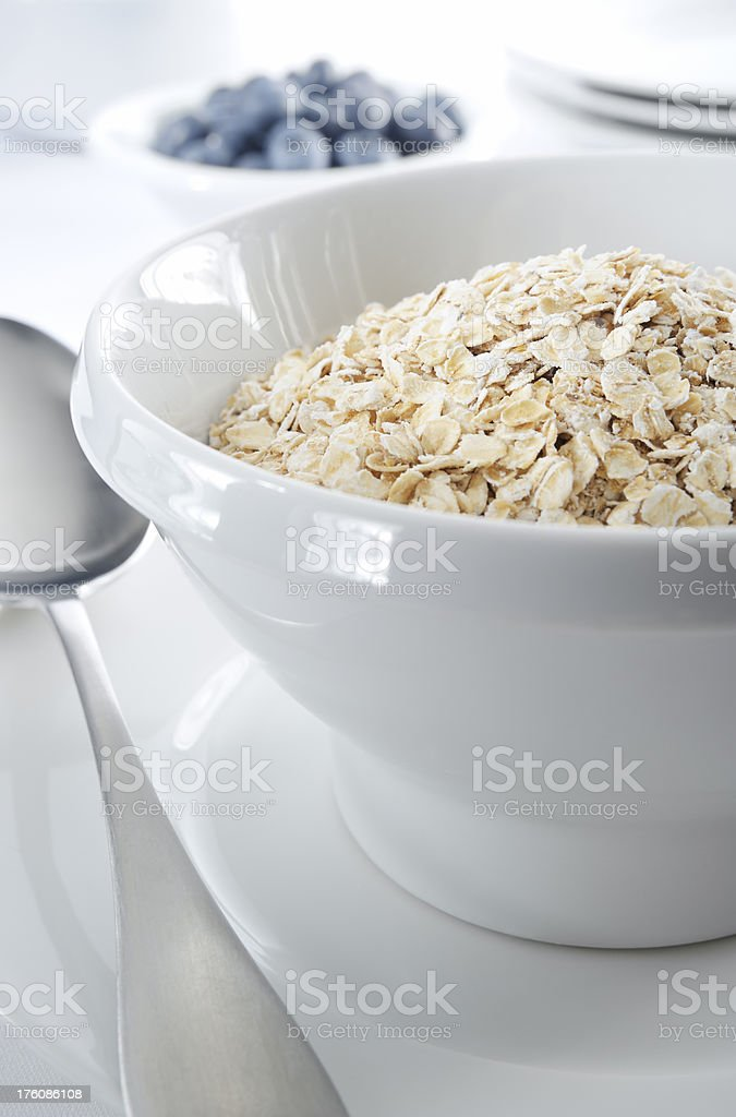 Bowl of oatmeal or cereal royalty-free stock photo