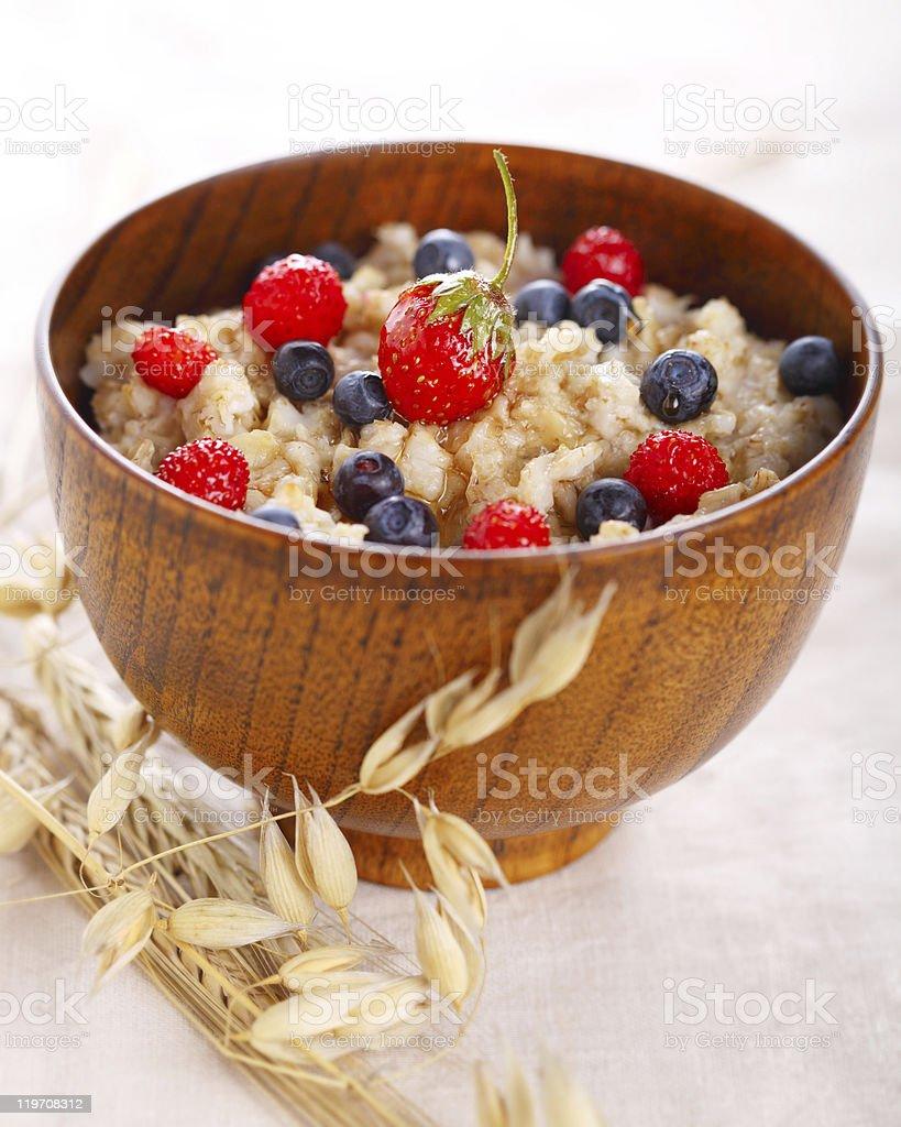 Bowl of oatmeal porridge. Healthy eating. royalty-free stock photo