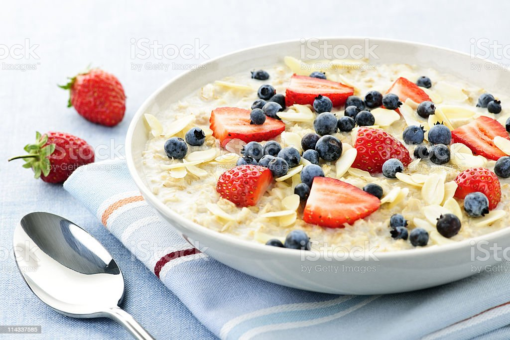 Bowl of oatmeal with berries stock photo