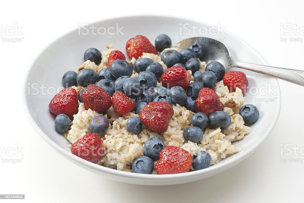 bowl of oatmeal with blueberries and strawberries royalty-free stock photo