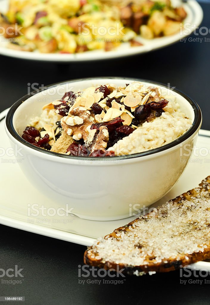 Bowl of oatmeal with nuts and dried fruit royalty-free stock photo