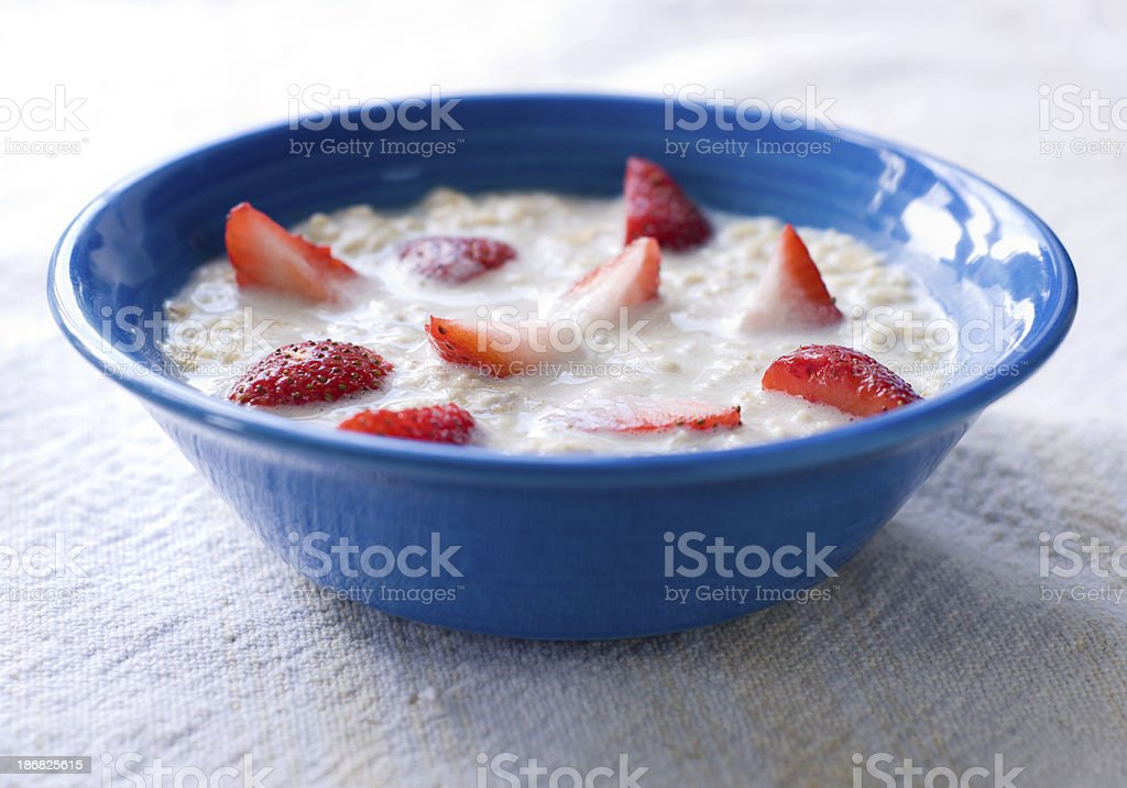Bowl of Oatmeal with Strawberries royalty-free stock photo