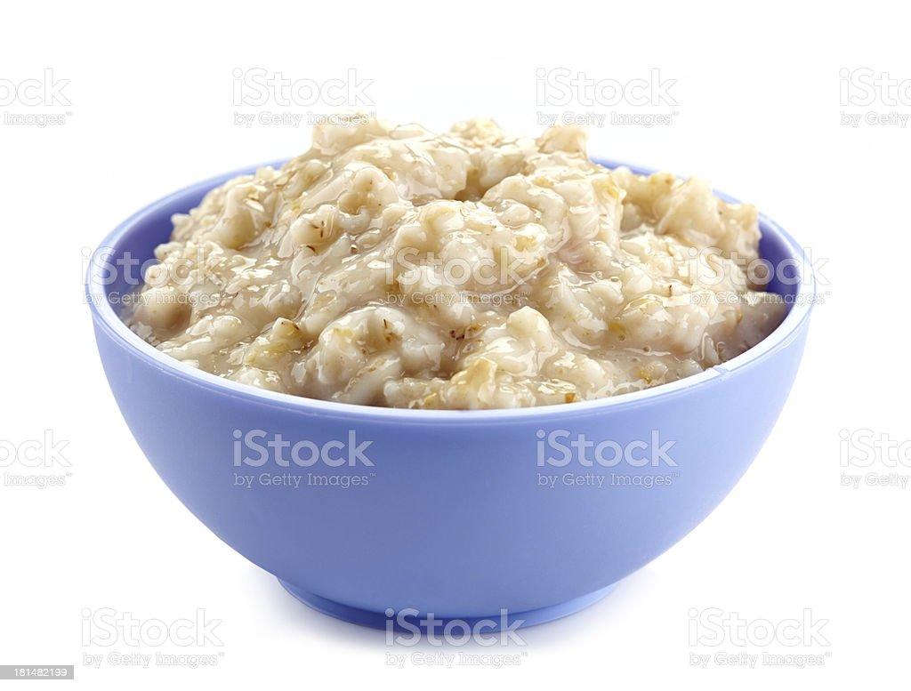 Bowl of oats porridge stock photo