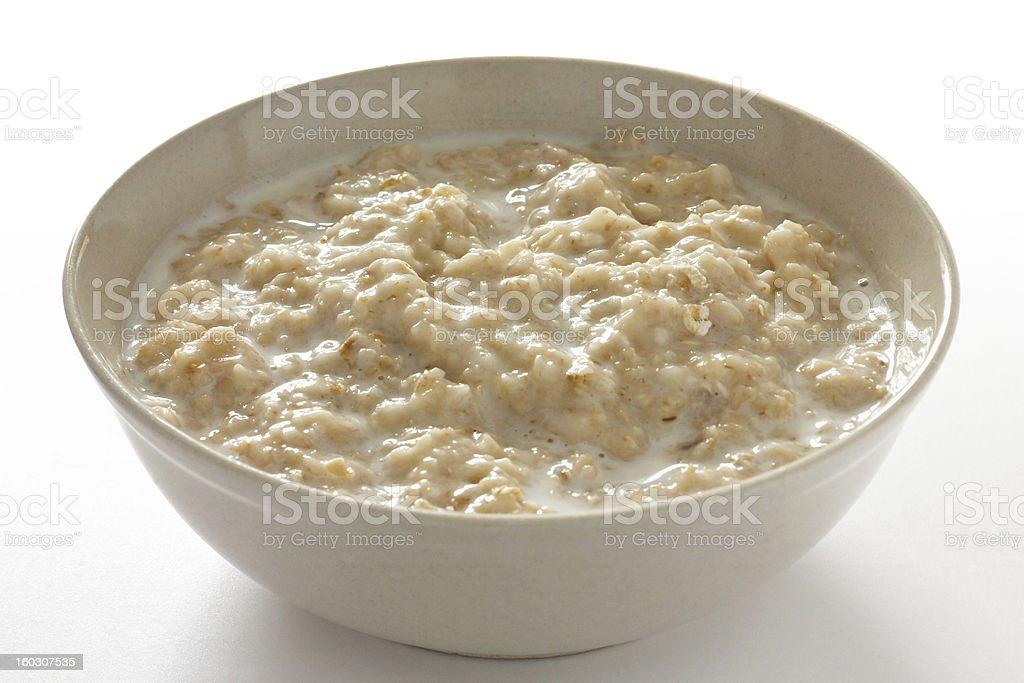 Bowl of oats porridge with milk stock photo