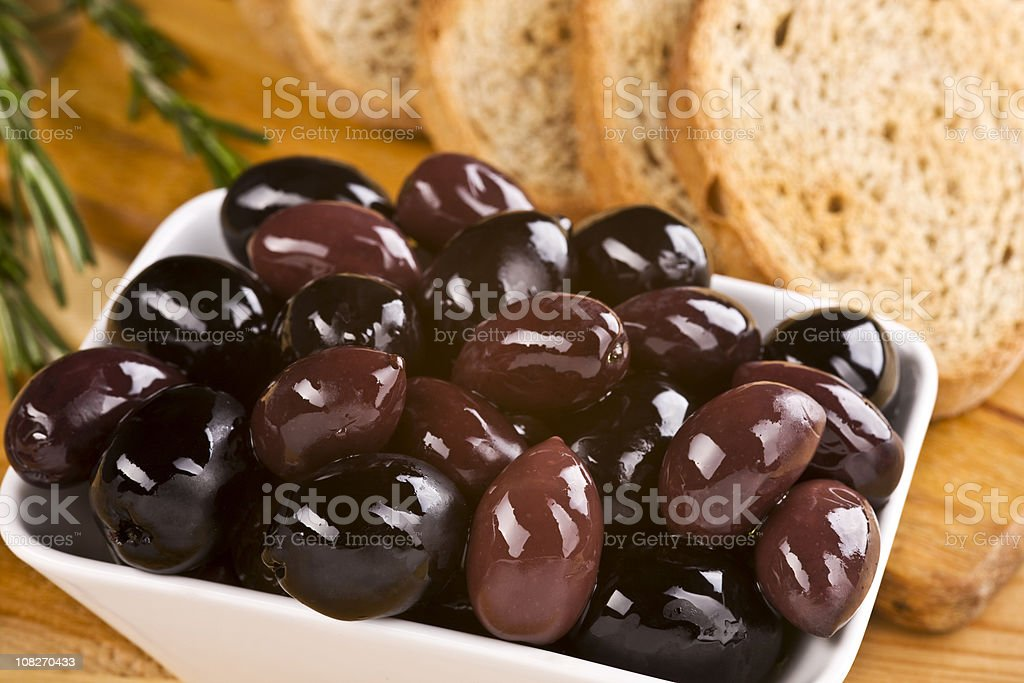 Bowl of Olives and Bread Slices with Rosemary royalty-free stock photo