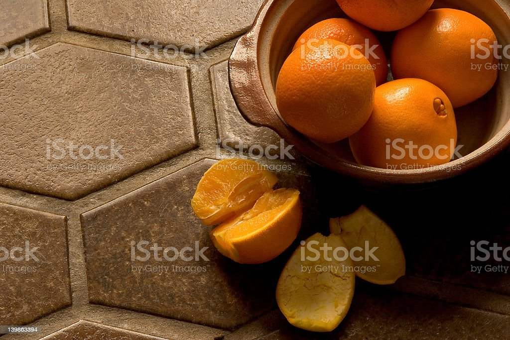 Bowl of oranges on Spanish tile floor royalty-free stock photo