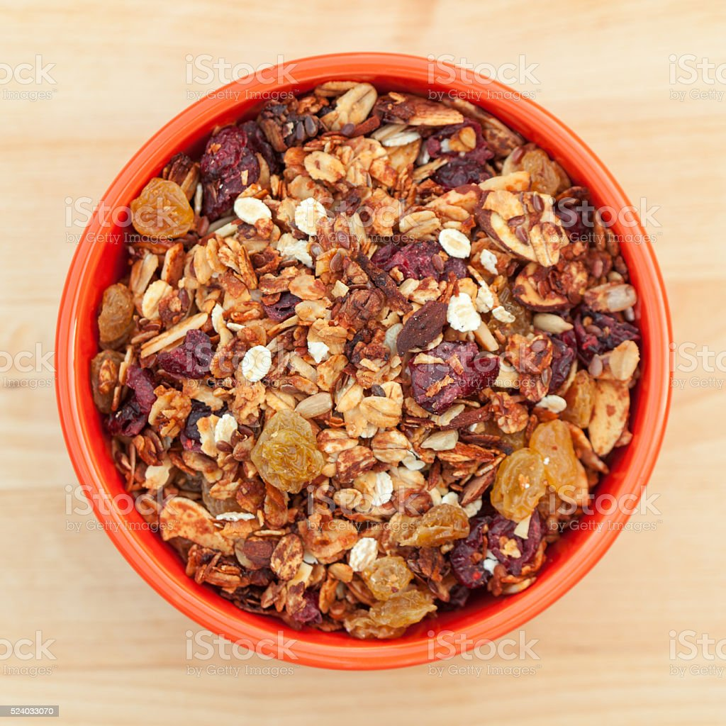 Bowl of organic granola cereal viewed from above stock photo