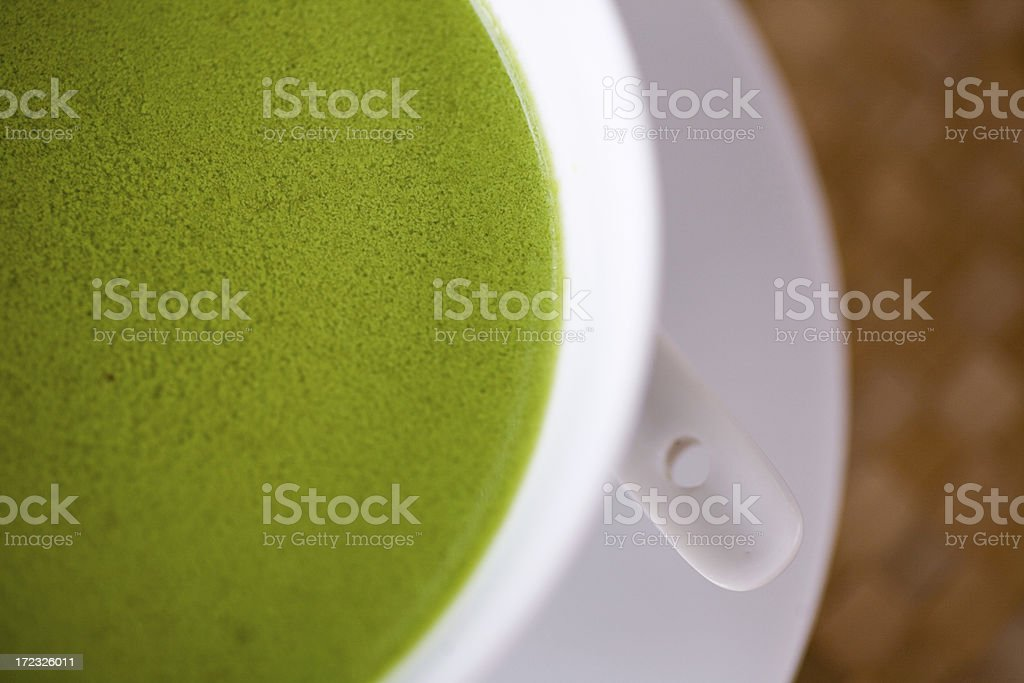 bowl of pea green soup macro stock photo