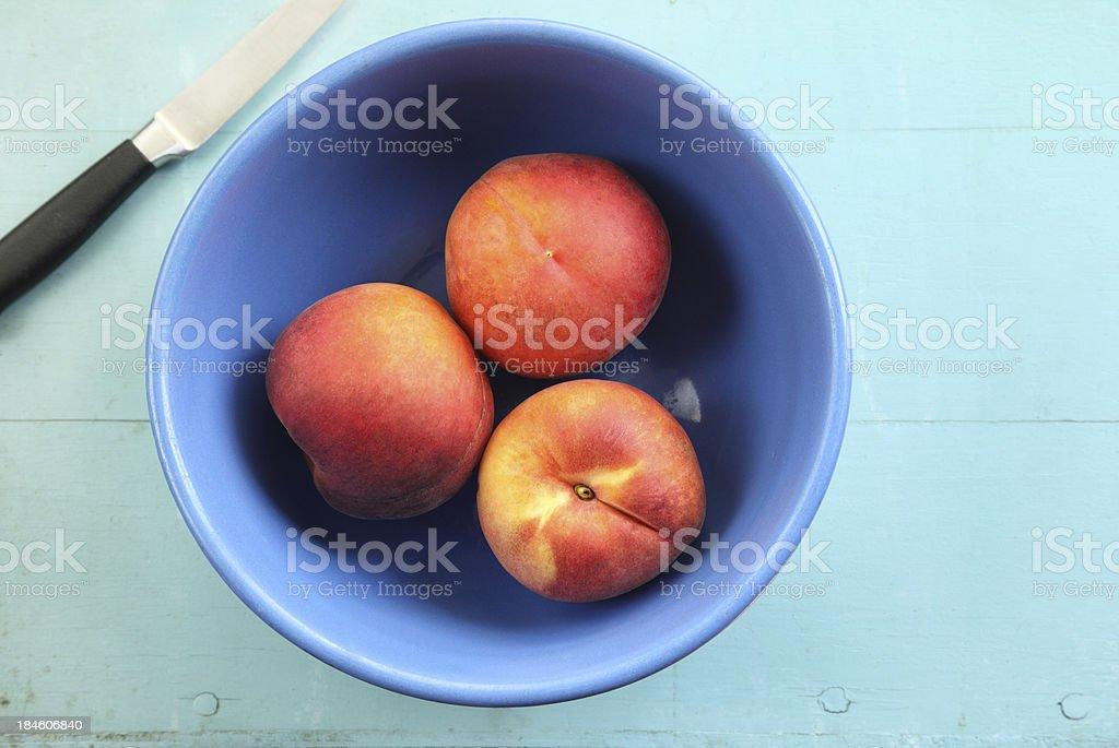 Bowl of Peaches stock photo