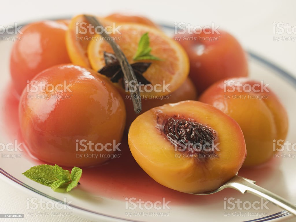 Bowl of Peaches Poached in Sauternes Wine stock photo
