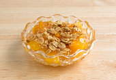 Bowl of peaches with brown sugar and oats