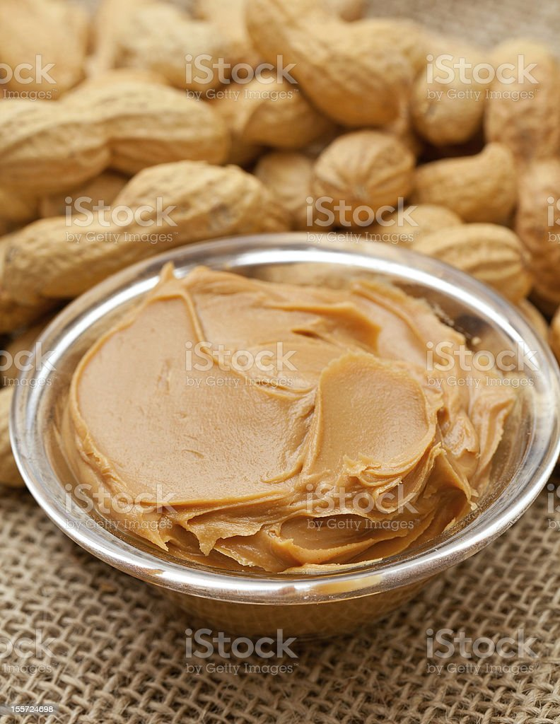 Bowl of peanut butter and peanuts in their shells royalty-free stock photo
