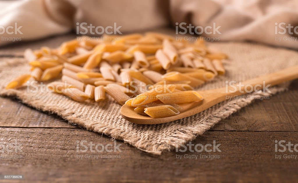 Bowl of penne noodles in rustic style stock photo