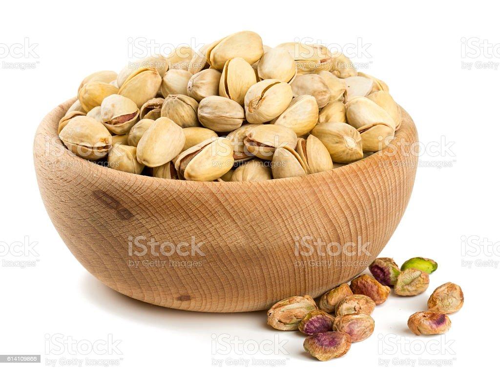 bowl of pistachio isolated on white stock photo