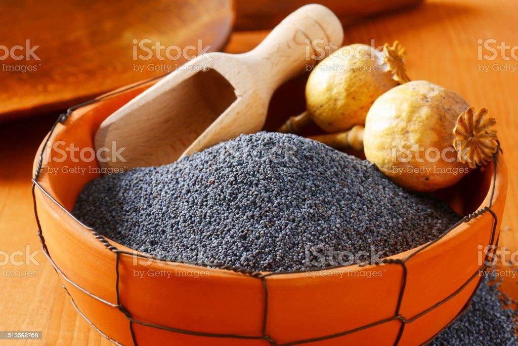 Bowl of poppy seeds stock photo