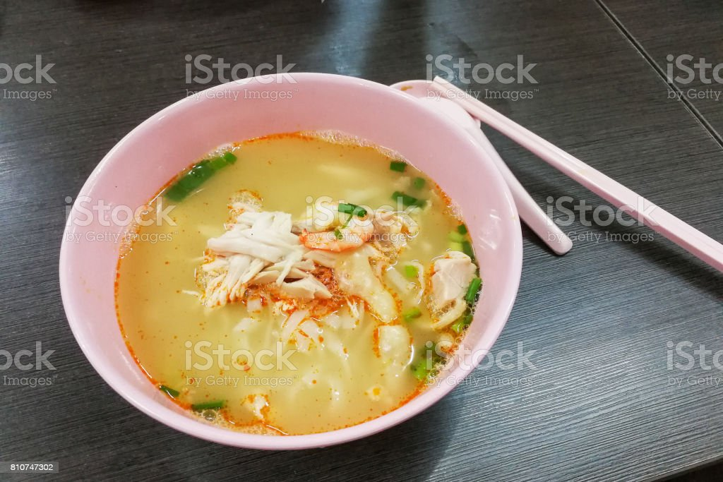 Bowl of popular delicious Malaysia Ipoh sliced chicken noodle soup stock photo