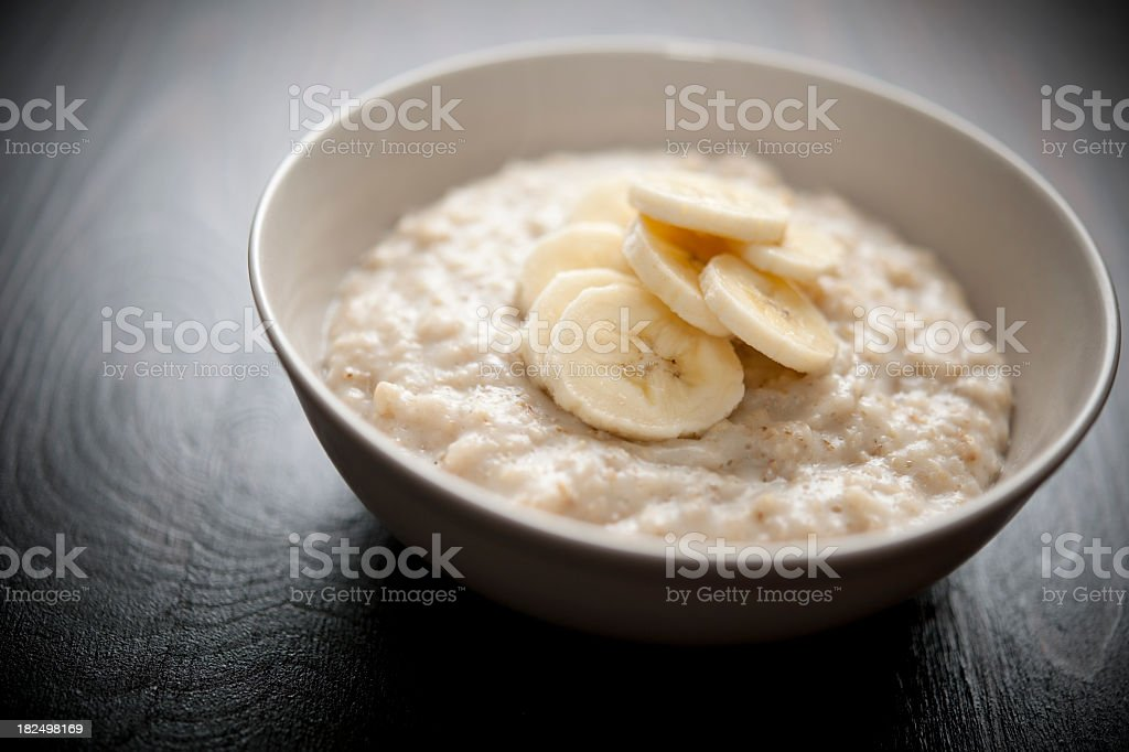 Bowl of porridge with sliced banana royalty-free stock photo
