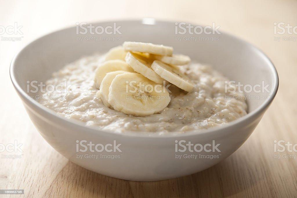 Bowl of porridge with sliced banana stock photo