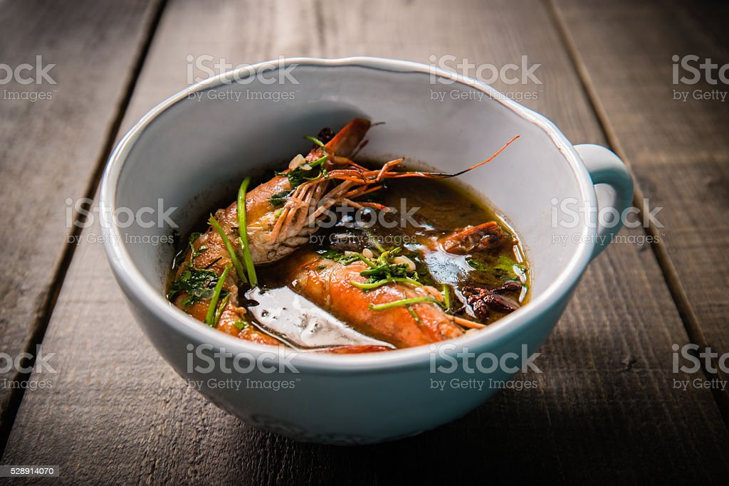 Bowl of Prawns in exotic spice broth stock photo
