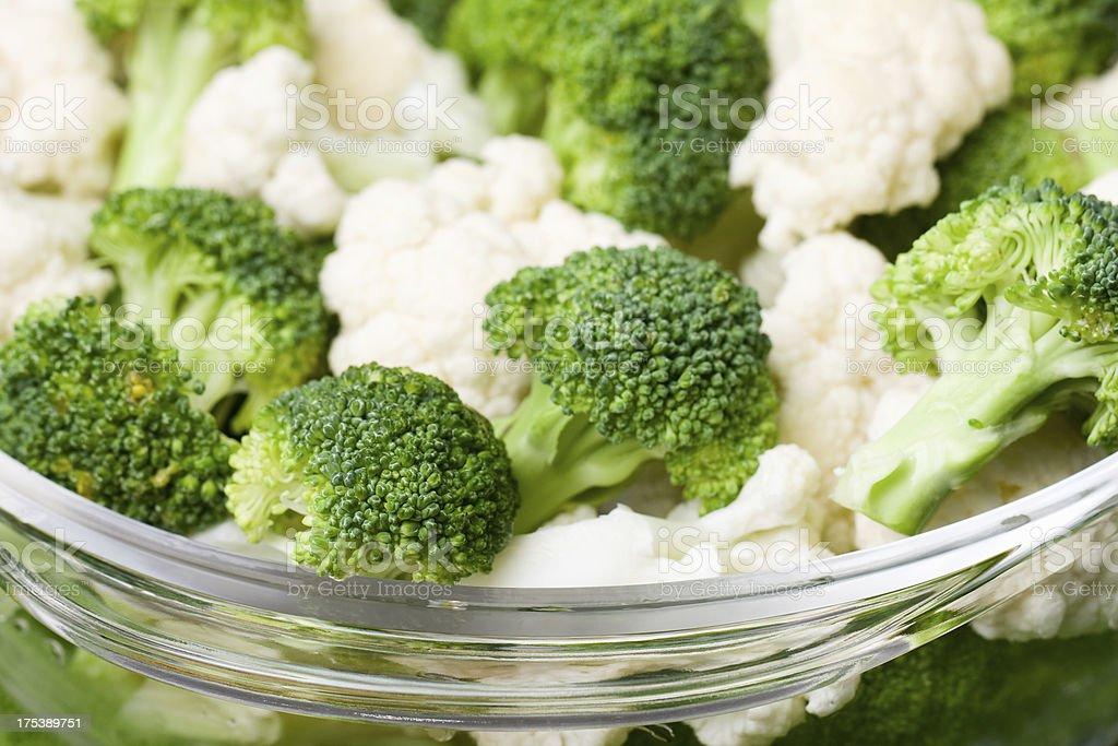 Bowl of Raw Broccoli and Cauliflower royalty-free stock photo
