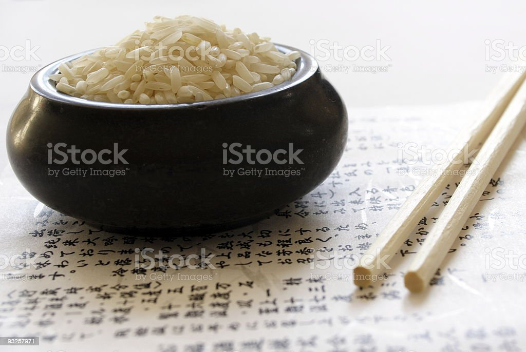bowl of rice and wooden chopsticks royalty-free stock photo