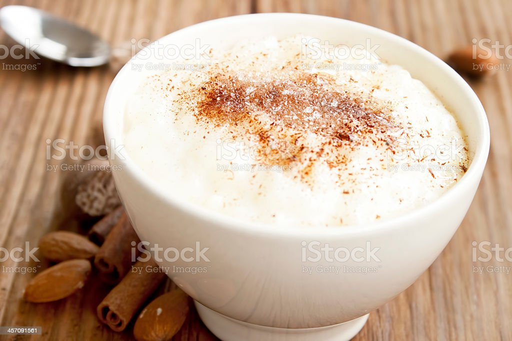 A bowl of rice pudding sprinkled with cinnamon powder stock photo