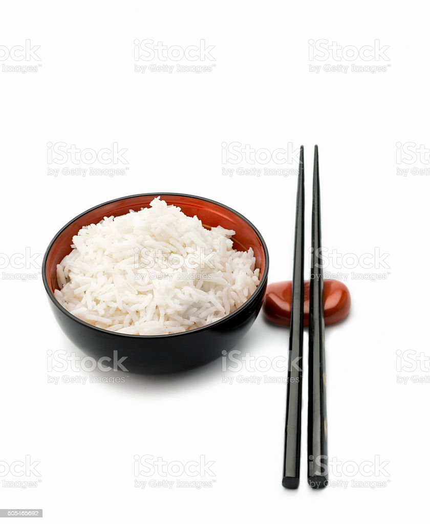 Bowl of Rice with black chopsticks. stock photo