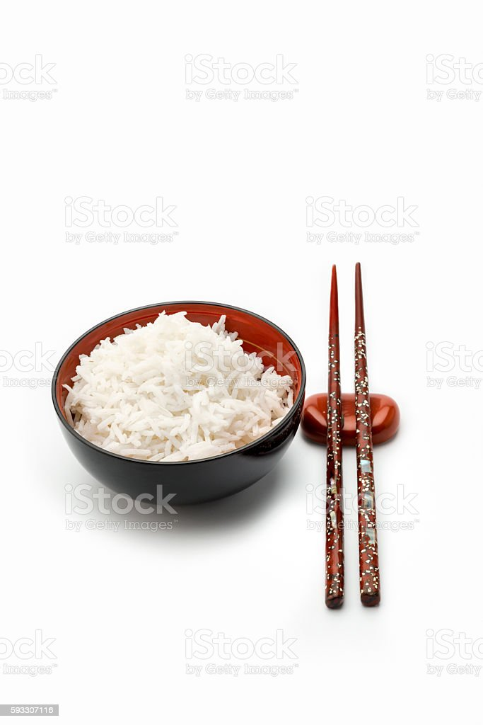 Bowl of Rice with red chopsticks. stock photo