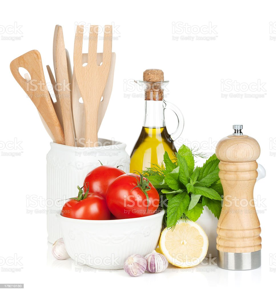 Bowl of ripe tomatoes with kitchen utensils and ingredients stock photo