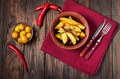 bowl of roasted potatoes with rosemary and tomatoes