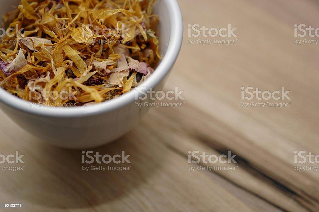 Bowl of rose, lavender and marigold herbal tea. royalty-free stock photo