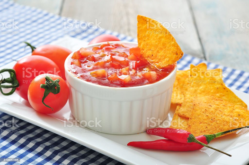 Bowl of salsa with tortilla chips stock photo