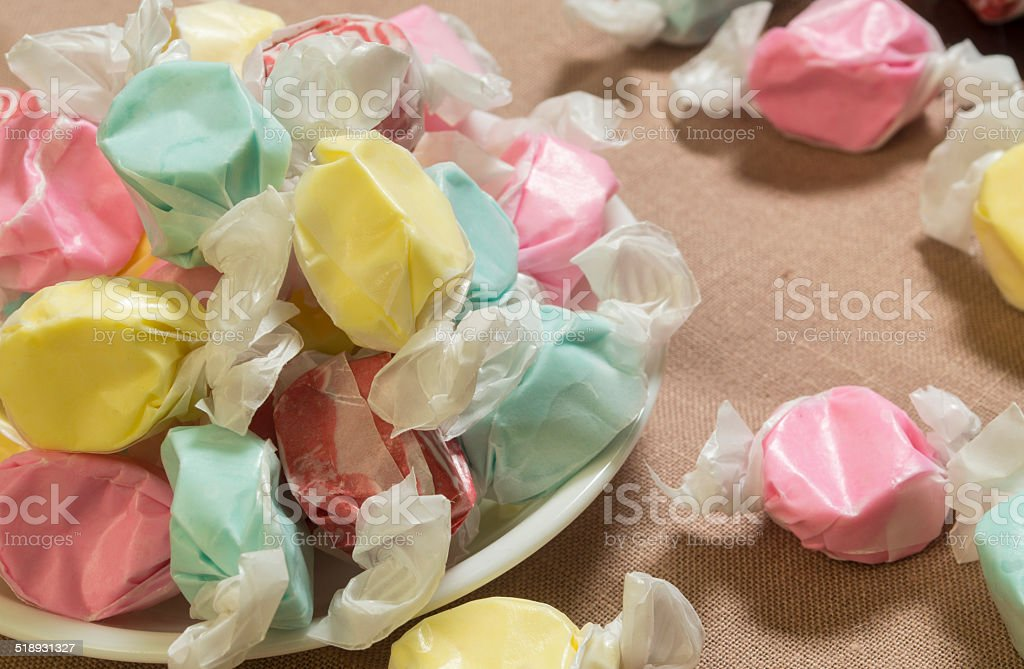 bowl of salt water sweet taffy stock photo