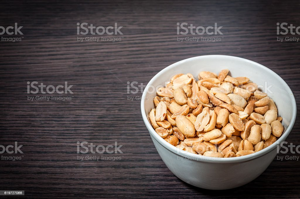Bowl of salted peanuts stock photo