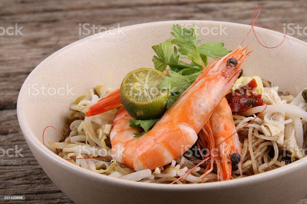 Bowl of Sarawak Laksa noodles stock photo