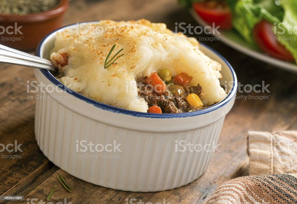 Bowl of shepherds pie on the dinner table stock photo