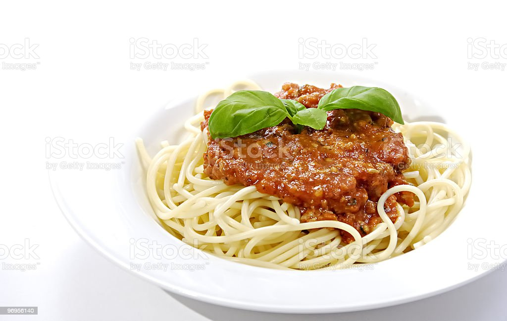 Bowl of spaghetti with sauce on a white background royalty-free stock photo