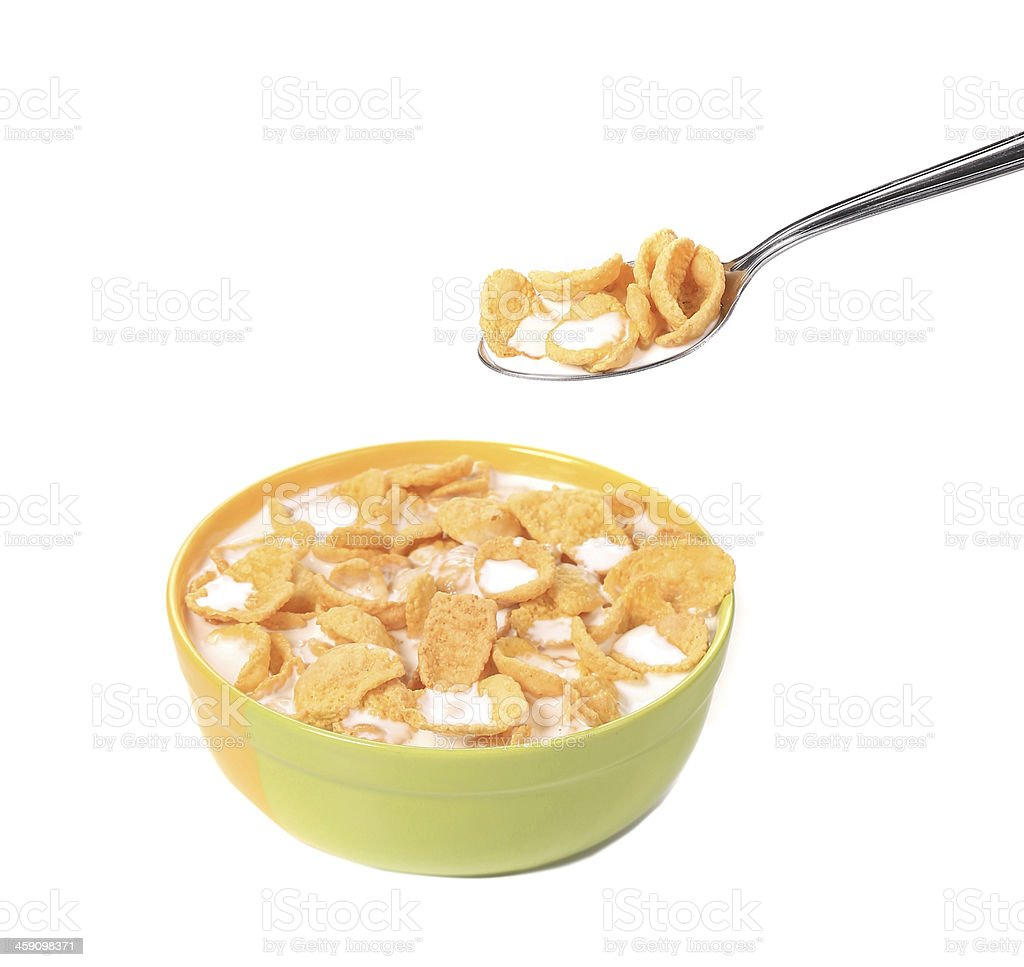 Bowl of sugar-coated corn flakes and spoon. stock photo